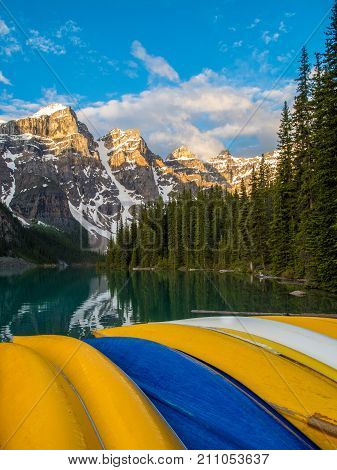 Colorful canoes at Moraine Lake, Banff National Park, Canada at sunrise