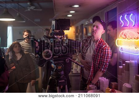 SAINT PETERSBURG, RUSSIA - JULY 22, 2017: Film Crew On Location. 4K Camera Cinematographer. Filmmaking. Set, scenery of the roadside cafe 80's style