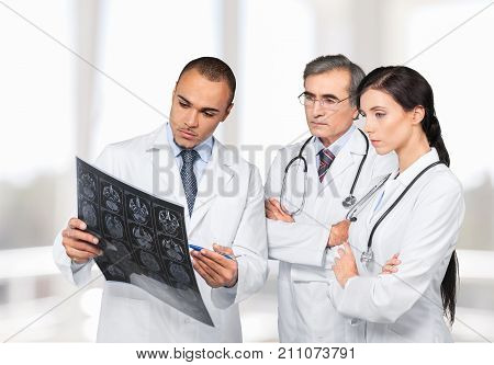 Holding man doctor x-ray color view years