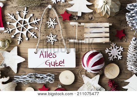 Signboard With German Text Alles Gute Means Best Wishes. Christmas Decoration Like Sled, Ball, Christmas Tree And Snowflake. Brown Rustic Woodn Background. Natural Style