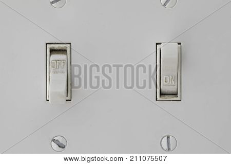 Two light switches with one in the off position and the other being on