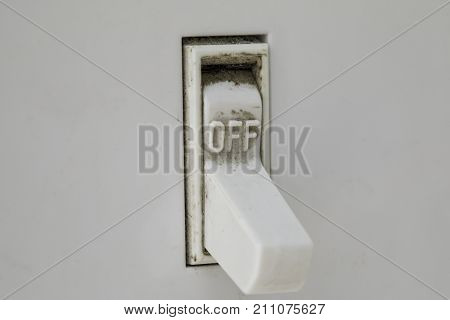 Macro shot of a dirty light switch in the off position