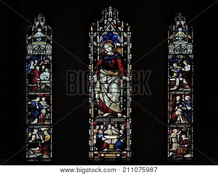 ROME, ITALY - SEPTEMBER 02: scenes from the life of saint John on the stained glass of All Saints' Anglican Church, Rome, Italy on September 02, 2016.