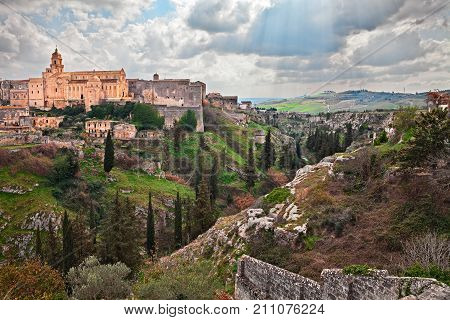 Gravina in Puglia, Bari, Italy: picturesque landscape of the the deep ravine and the old town with the ancient cathedral
