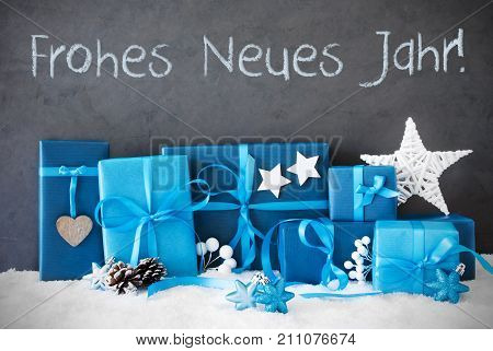 Concrete Wall With German Text Frohe Neues Jahr Means Happy New Year. Blue Christmas Gifts With Decoration Like Stars And Fir Cone On Snow.