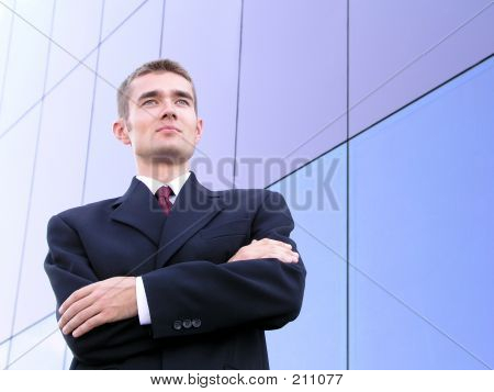 businessman with his arms crossed poster