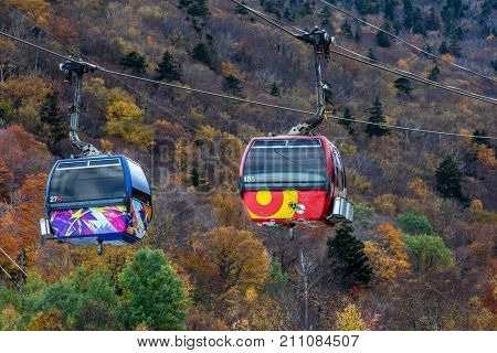 KILLINGTON, USA - OCTOBER 13, 2017:  Two Express K1 Gondola at Killington Mountain Resort in Fall view in Vermont, USA, 2017