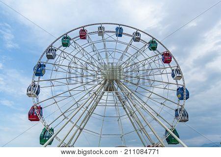 Colorful Ferris wheel against blue sky, blue sky, ferris wheel