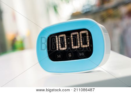 10 Minutes - Digital Blue Kitchen Timer On White Table