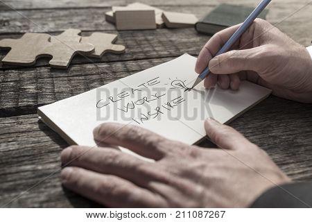 Businessman Writing An Inspirational Message