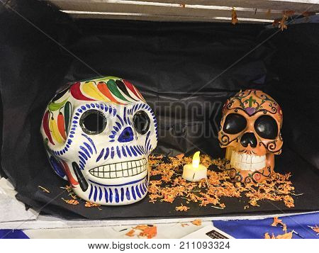 XALAPA, VERACRUZ, MEXICO- NOVEMBER 27, 2017: Painted skulls in a little offering altar, part of a Day of the Dead festival in Xalapa, Veracruz, Mexico