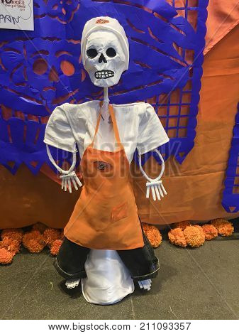 XALAPA, VERACRUZ, MEXICO- OCTOBER 27, 2017: Chef skull doll. Part of a mexican day of the dead offering altar