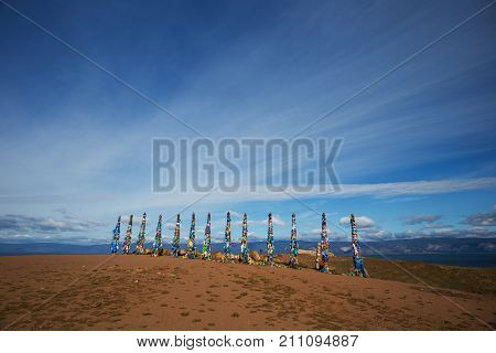 Poles hitching post near Khuzhir at Olkhon island in Siberia, Russia.