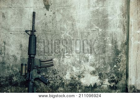 M4A1 (AR-15) M-16 assault rifle gun for the American military is placed beside the old wall.