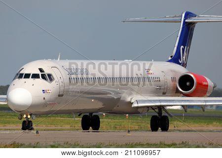Sheremetyevo, Moscow Region, Russia - May 12, 2012: McDonnell Douglas MD-82 SE-DIK of SAS Scandinavian Airlines taxiing at Sheremetyevo international airport.