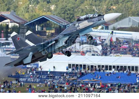 Zhukovsky, Moscow Region, Russia - August 30, 2015: Sukhoi Su-30SM 38 BLACK of russian navy perfoming demonstration flight in Zhukovsky during MAKS-2015 airshow.