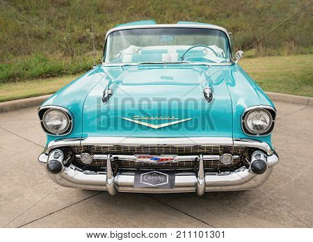 Westlake Texas - October 21 2017: Front view of an aqua color 1957 Chevrolet Bel Air convertible classic car.