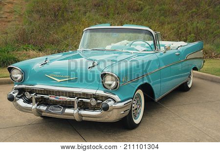 Westlake Texas - October 21 2017: Front side view of an aqua color 1957 Chevrolet Bel Air convertible classic car.