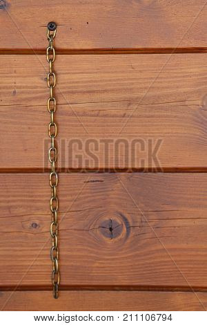 Background Of Wood With Vertical Metal Chain And Space To Write