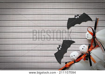 Halloween, celebration or holiday background concept : Halloween paper crafts on tablecloth background, Top view or flat lay with copy space