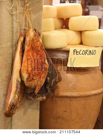 Salami And Pecorino Cheeses In The Shop Of Italian Products