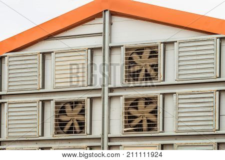 Fragment of the facade of an agricultural poultry house with a facade air exchange system. Agro industry aviculture complex.