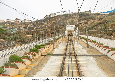 Funicular railway in Nazare, Central Portugal. Ascensor of Nazare is a funicular, leading up to scenic overlook of Nazare Sitio, the upper part of city above giant cliffs.
