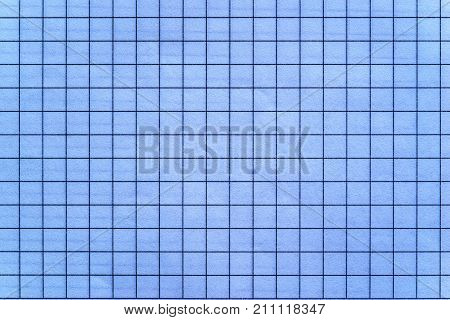 the sheet of checkered paper of a notebook for arithmetics and for a school background or for wallpaper