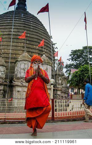 GUWAHATI ASSAM INDIA - JULY 4 2014 : Hindu Sadhu standing by one bare foot for hours at famous Kamakhya Temple or Kamrup-Kamakhya temple dedicated to mother goddess Kamakhya.