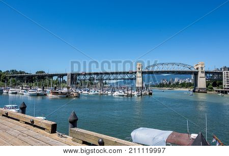 Vancouver, Canada - June 23, 2017: Boats In The Burrard Civic Marina With Vancouver's Downtown In Th