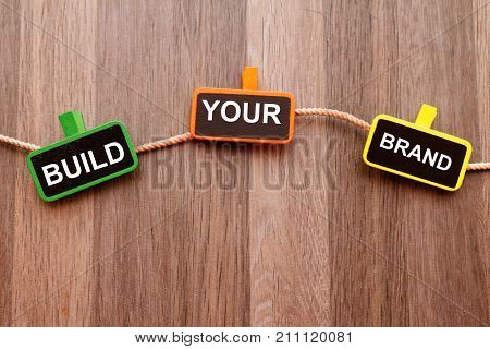 Build your brand concept on wooden background