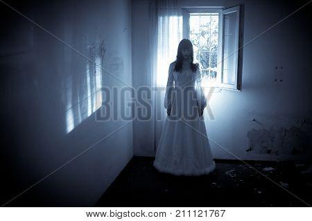 Horror Scene of a Creepy Woman in the Long Wedding Dress