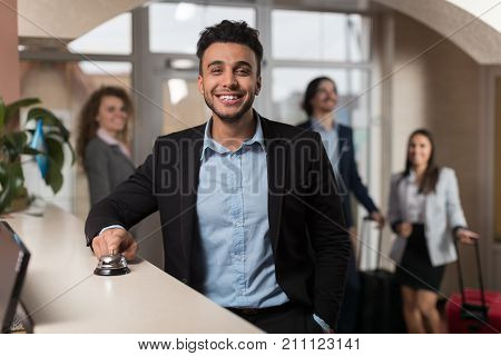 Hispanic Business Man Arrive To Hotel Waiting For Check In Registration Business People Group In Lobby, Guests Arrive