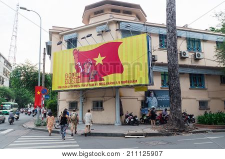 Ho Chi Minh City Vietnam - August 19 2017: Communist propaganda billboard on the side of a building in central Ho Chi Minh City.