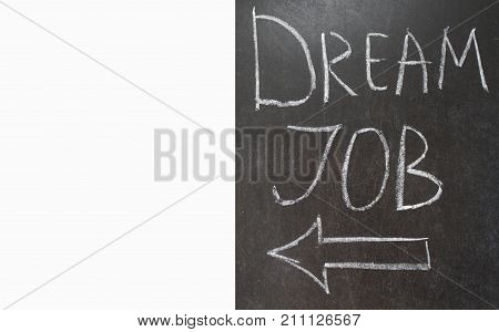 DREAM JOB message and left arrow sign hand written on the blackboard with white chalk.  Copy space for text . Banner for job search.