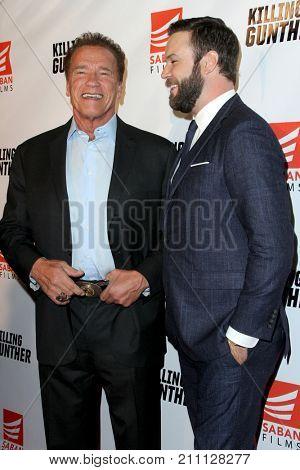 LOS ANGELES - OCT 14:  Arnold Schwarzenegger, Taran Killam at the