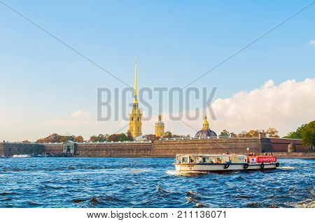 ST PETERSBURG RUSSIA-OCTOBER 3 2016. St Petersburg city panorama. Peter and Paul fortress at Hare island with touristic sailboat at Neva river in St Petersburg Russia