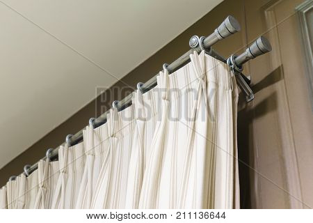 The white curtains with ring-top rail Curtain interior decoration in living room
