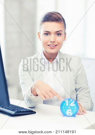 picture of attractive businesswoman pointing at clock