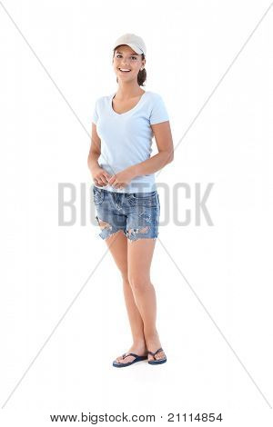 Schoolgirl in shorts at summertime, smiling, looking at camera.?
