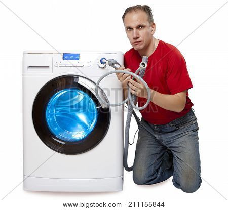 The man who has thought of repair or connection of the washing machine near the new washing machine