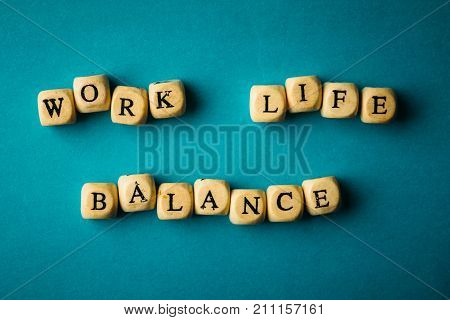 Work Life Balance -  wooden cubes with letters on blue background, Business work-life concept