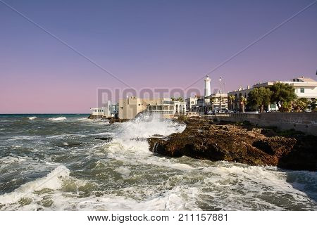 Shaky sea and rocks on the waterfront of Torre Canne