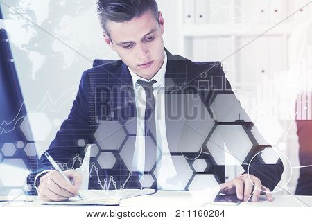 Serious young manager with fair hair wearing a suit is working with papers in his office. Concept of a business lifestyle. Toned image double exposure