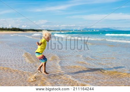 Child On Tropical Beach. Sea Vacation With Kids.