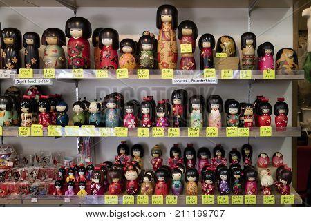 Miyajima, Japan - May 26, 2017: Traditional wooden Japanese kokeshi dolls for sale as souvenir