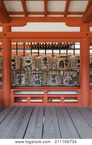 Miyajima - Japan, May 26, 2017:  Traditional sake barrels at the famous the Itsukushima Shrine on Miyajima