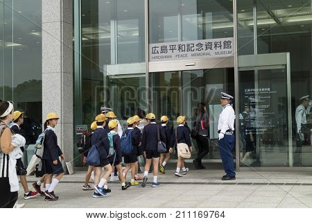 Hiroshima, Japan - May 25, 2017 :Group of students walking into the Hiroshima Peace Memorial Museum in Peace Memorial Park