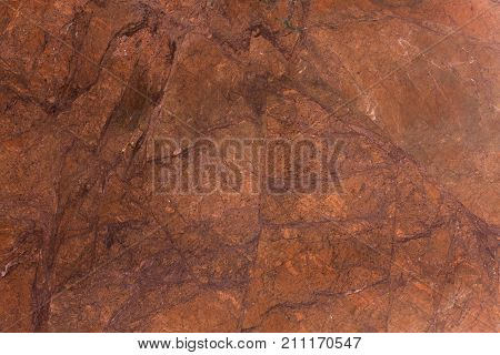 Brown stone background of mottled granite igneous rock. High resolution photo.