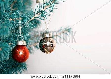 Chrismas balls background. Christmas baubles hanging on a Cedar tree branch.
